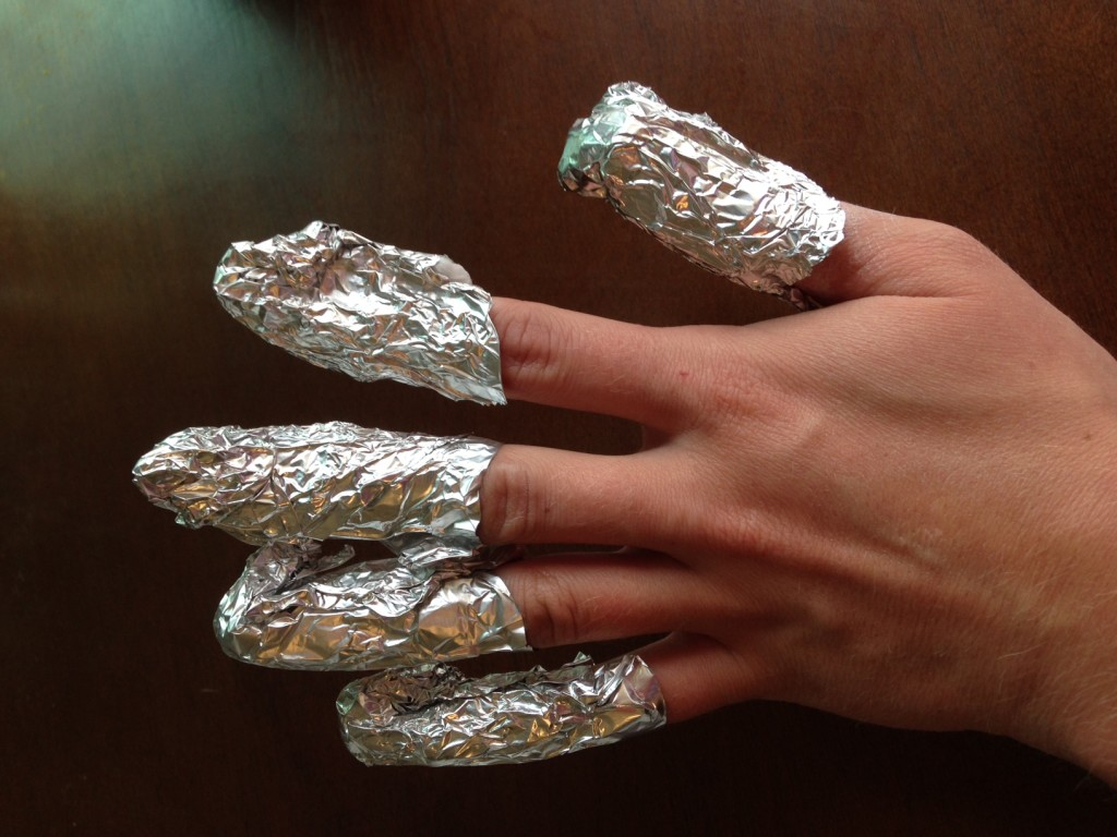 Hand with finger tips wrapped in aluminum foil